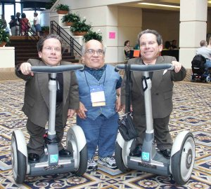Three men with SEDC on Segways at an LPA Conference