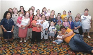 Group of 30 people with Kniest, SED or SMD taken at an LAP conference. Attendees are of many ages and ethnicities. There are several adorable children in this photo.